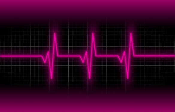 Electrocardiogram - Concept of healthcare, heartbeat shown on monitor - pink