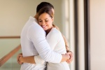 woman hugging her husband